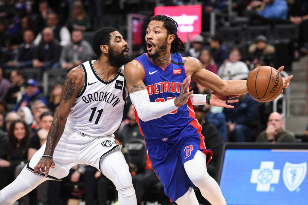 Jan 25, 2020; Detroit, Michigan, USA; Detroit Pistons guard Derrick Rose (25) drives to the basket against Brooklyn Nets guard Kyrie Irving (11) during the first quarter at Little Caesars Arena. Mandatory Credit: Tim Fuller-USA TODAY Sports